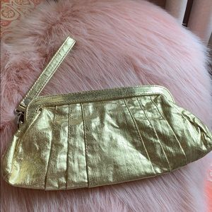 Gold shiny clutch with strap